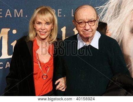 "NEW YORK-DEC 10: Elaine Joyce and Neil Simon attend the premiere of ""Les Miserables"" at the Ziegfeld Theatre on December 10, 2012 in New York City."