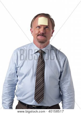 Mature Businessman With Stick Note On Forehead