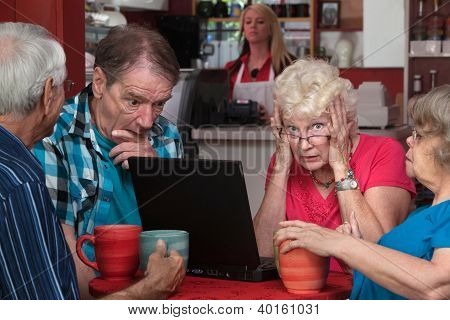 Lady And Friends With Laptop Problem