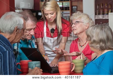 Woman Helping Seniors With Computer