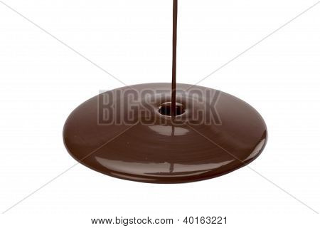 Pouring Of Chocolate On A White Surface