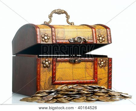 Opened antique wooden treasure chest with coins.