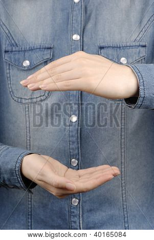 Closeup Woman`s Hands Isolated On Jeans Background