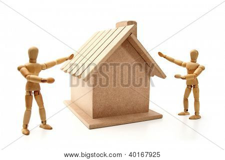 Dummies showing a new house.