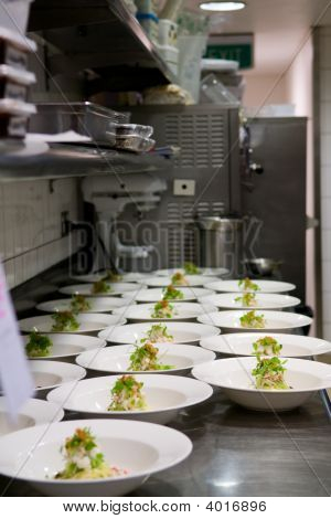 Neat Rows Of Prepared Food In A Busy Kitchen