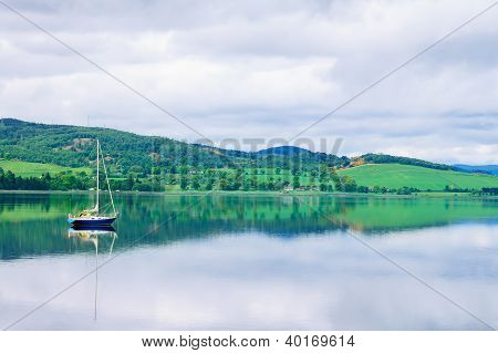 Sailing Boat In Moray Firth Near Loch And River Ness. Landscape In Inverness Highlands Of Scotland,