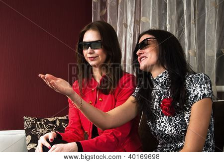 Young Beautiful Women At Home Watching A 3D Movie