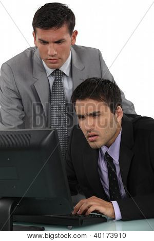 Puzzled businessmen with a laptop