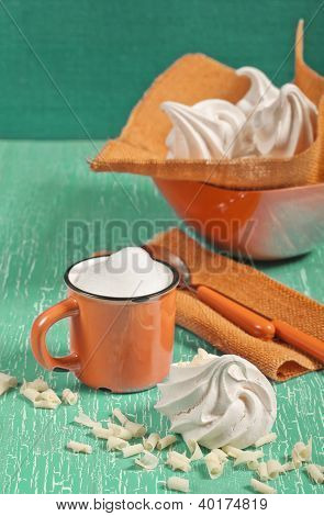 Side View Of Meringues And Orange Cup
