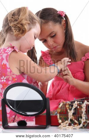 Girls putting on jewellery