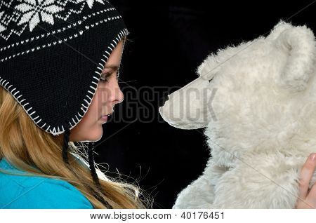 Girl In A Cap With A Toy