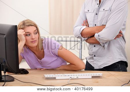 Young woman sprawling on her desk