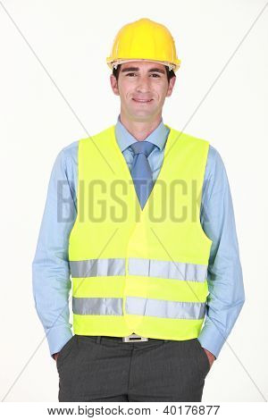 Man with helmet and reflective vest