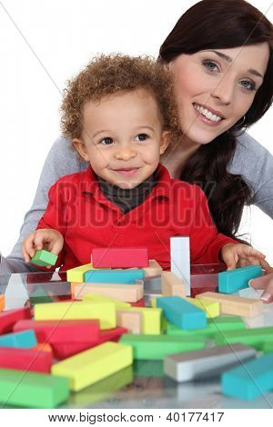 Mother sat with son playing building blocks