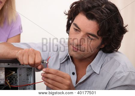 Man fixing a hard drive