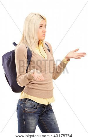 A blond female student with backpack gesturing - I do not know