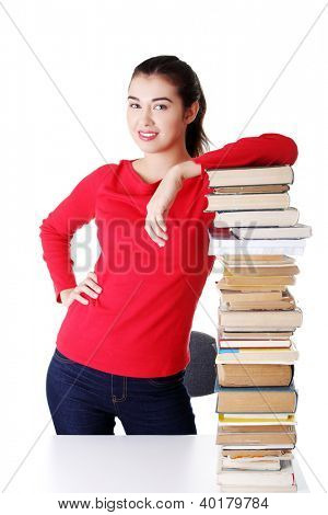 Happy young student woman with books, isolated on white background