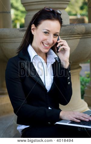 Cheerful businesswoman outdoors
