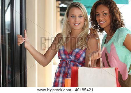 portrait of 2 girls with shopping bags
