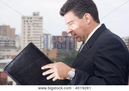 Businessman Reading An Inform