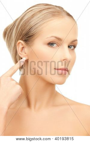 picture of beautiful woman pointing to ear