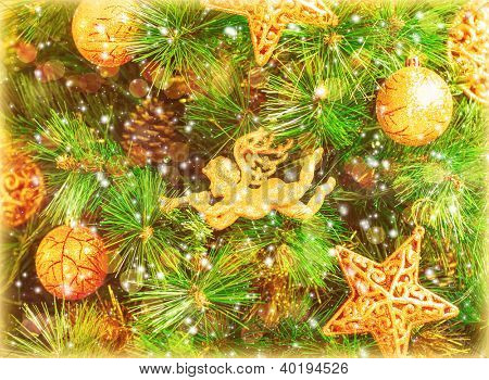 Photo of Christmas tree background, green fir tree decorated with golden festive toys, decorative angel, star and bauble hanging on spruce, Christmastime home interior, magical holiday night