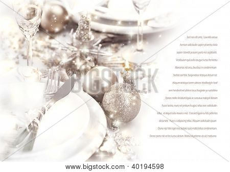Image of romantic holiday dinner, festive table setting decorated with beautiful silver bubbles and candles, luxury white plate served with shiny knife and fork, wedding day, love story