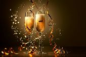 stock photo of processor  - Two champagne glasses ready to bring in the New Year - JPG