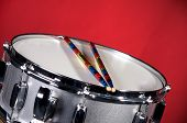 Silver Sparkel Snare Drum And Sticks Isolated On Red poster
