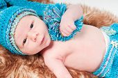 stock photo of pon  - Newborn baby in long blue knitted hat with pom - JPG