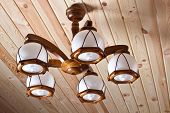 picture of flambeau  - beautiful wooden electric chandelier on wooden ceiling - JPG