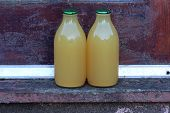 stock photo of milkman  - apple juice bottles after a doorstep delivery - JPG