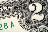 image of two dollar bill  - A close of a two dollars text - JPG