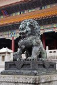 image of plinth  - Chinese stone lion on raised plinth outside temple - JPG