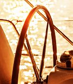 foto of rudder  - Image of sailboat helm on sunset - JPG