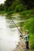 foto of spinner  - photo of little fisher boy on coast of river - JPG
