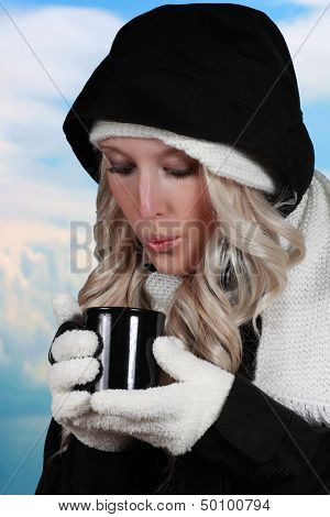 Young Woman Drinking Coffee Outside