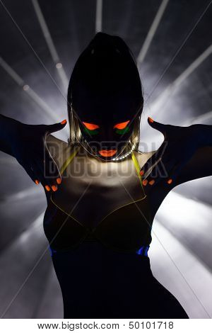 Silhouette of slender girl with UV makeup