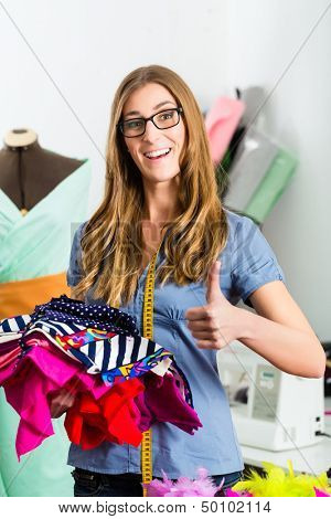 Freelancer - Fashion designer or Tailor working on a design or draft, she is successful in the business