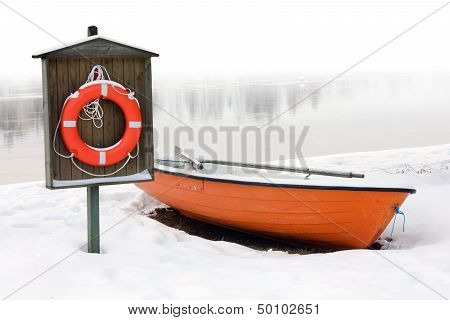 Lifeboat And Lifebuoy On The Snow