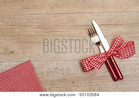 Table Of Wood With Knife, Fork And Napkin