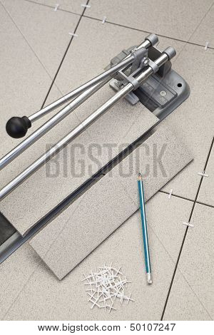 Tiles Cutting Works With Close-up Of Tile-cutter On Floor
