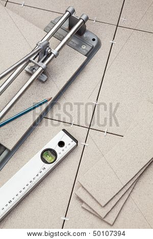 Tools For Installing The Floor From A Ceramic Tiles