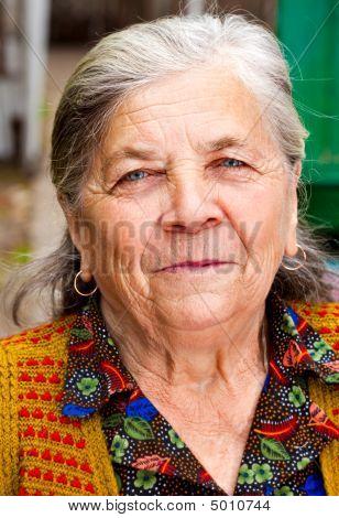Closeup Portrait Of One Content Senior Woman