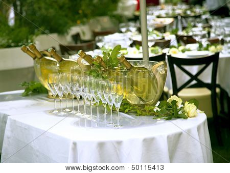 Bottles of champagne in a glass bucket