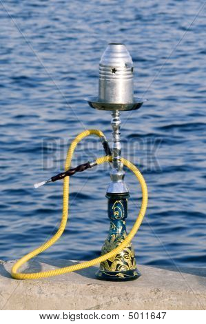 Turkish Tobacco Water Hookah Standing Over The River Background