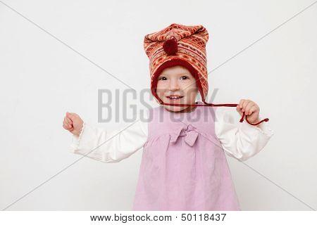 Little Girl Wearing A Hat