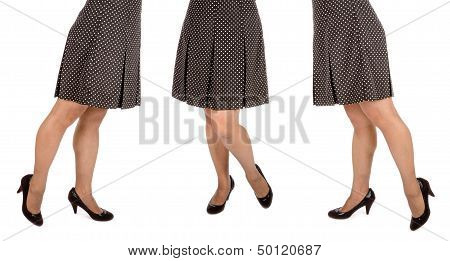 Woman Wearing Polka Dot Mini Skirt Isolated on White