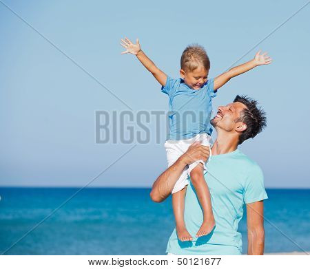 father and son having fun on...