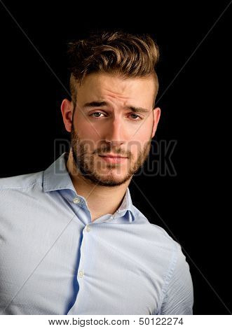 Handsome Young Man Portrait With Doubtful, Unsure Expression